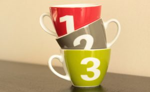 3 colourful coffee cups stacked on top of each other