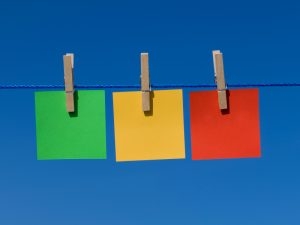 coloured tags pegged to a line