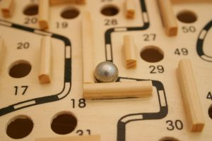 Maze puzzle with metal ball and obstacles