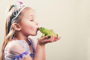 young princess kissing a frog