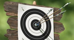 archery board with three arrows in middle
