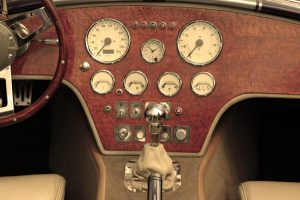 buttons and dials on dashboard of vintage car