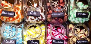 jars filled with colourful lollipops