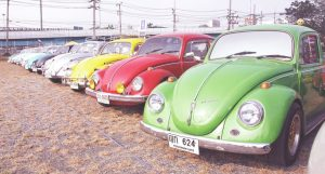 colourful VW beetles parked in a line