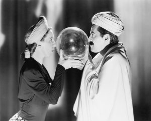 man and woman with faces pressed against crystal ball